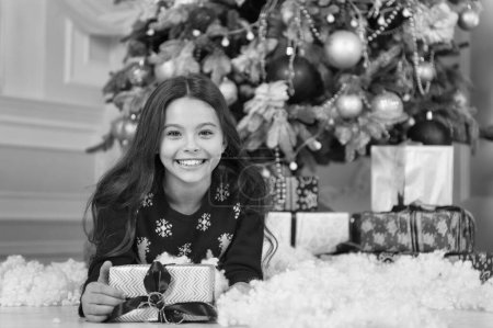 Photo for Small happy girl at christmas. Christmas. Kid enjoy the holiday. The morning before Xmas. New year holiday. little child girl likes xmas present. Happy new year. Christmas is coming. The best present - Royalty Free Image