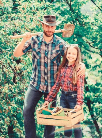 My job is my passion. spring village country. little girl and happy man dad. earth day. new life. ecology environment. soils and fertilizers. family farm. agriculture. father and daughter on ranch