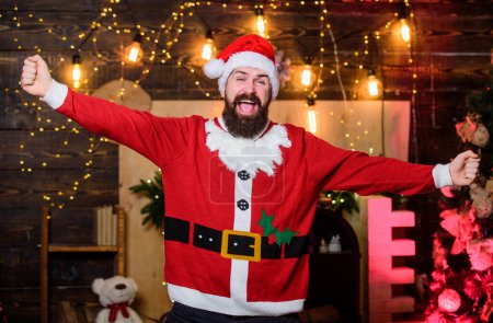 Photo for Santa claus costume. New year celebration. Tradition celebration. Celebrate winter holidays. Indulge yourself in joy. Celebration time. Man bearded santa celebrate christmas at home. Winter carnival. - Royalty Free Image