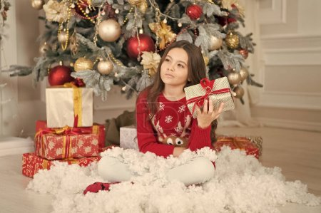 Photo for Sad little girl celebrate winter holiday. happy new year. christmas time. Cute little child girl with xmas present. delivery christmas gifts. Dear santa. Celebrating New Year together. - Royalty Free Image
