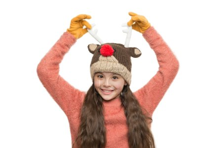 Photo for Cheerful kid. Playful cutie. Adorable baby wear cute winter knitted hat. Cute reindeer with red nose. Cute accessories. Girl wear winter theme accessory. Christmas time. Fun and joy. Festive spirit. - Royalty Free Image