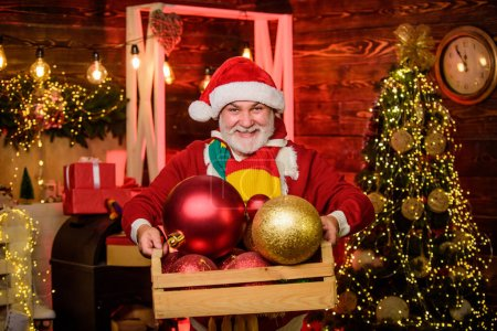 Photo for Our home. happy santa with beard. mature bearded elf. decorate your xmas. Time for presents. new year at home. winter holiday weekend. man decorative ball. Gift shopping. christmas tree decoration. - Royalty Free Image