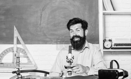 Photo for Science chemistry concept. bearded man teacher. back to school. Modern Laboratory. Biologist Conducts Experiments by Synthesising Compounds. chemistry class. - Royalty Free Image