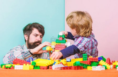 Photo for Family bonds. happy family leisure. small boy with dad playing together. father and son play game. child development. building home with colorful constructor. Home atmosphere. home is best. - Royalty Free Image