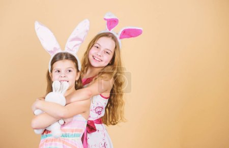Photo for Happy easter. Holiday bunny girls with long bunny ears. Children bunny costume. Playful girls sisters celebrate easter. Spring holiday. Happy childhood. Easter day. Easter activities for children. - Royalty Free Image