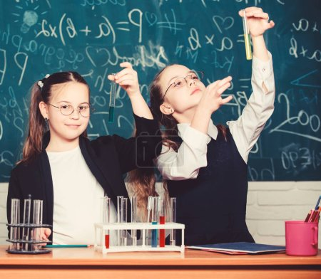Photo for Happy children. Biology lesson. students doing biology experiments with microscope in lab. Biology equipment. biology education. Little kids learning chemistry in school laboratory. Scientist at work. - Royalty Free Image