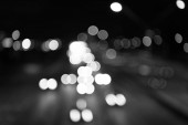 Night city lights. Illumination and lighting. White and red blurred lamps. Watching transport moving in street. Urban traffic. Blurred car lights night. Urban night. Lights defocused background