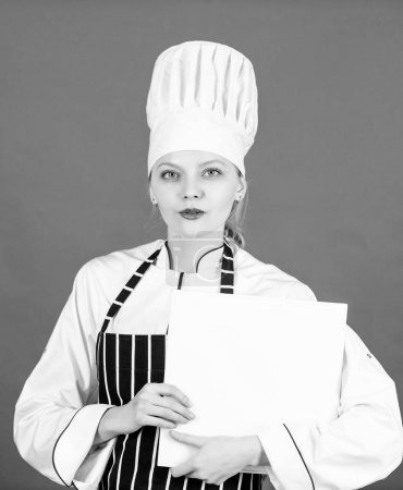 Photo for Housewife with cookery book. restaurant menu. Culinary dieting. woman in cook hat and apron. professional chef in kitchen. Cuisine. woman cooking healthy food by recipe. Sweetie beauties. - Royalty Free Image