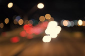 Urban traffic. Blurred car lights night. Urban night. Lights defocused background. Night city lights. Illumination and lighting. White and red blurred lamps. Watching transport moving in street
