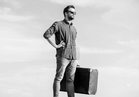 Photo for Everything for travel. traveler wait for flight. Move. sexy man sky background. male fashion style. looking so trendy. macho man tourist tour bag. businessman in glasses. business trip. - Royalty Free Image