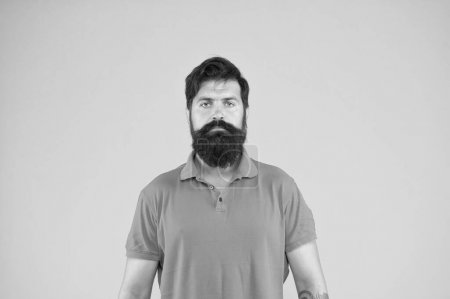 Photo for Full beard looks wild. Deal with ingrown hairs irritation. Beard design shape for facial hair. Essential products for maintaining beard care. Bearded hipster brutal guy. Manhood concept. Hairdresser. - Royalty Free Image
