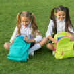 Doing homework better outdoors. Small children do ...