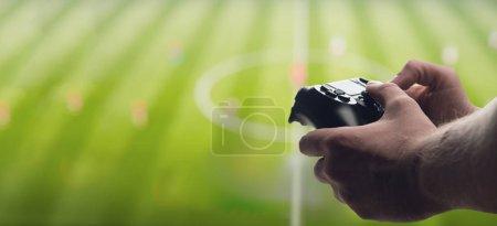 Gamepad in male hands