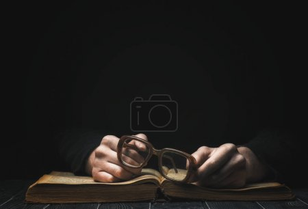 Photo for Book and glasses. man reading book - Royalty Free Image