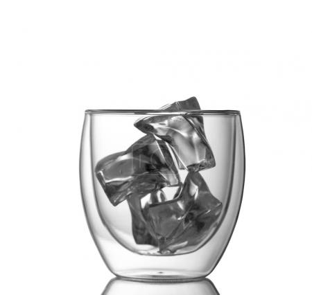 Glass with ice on white