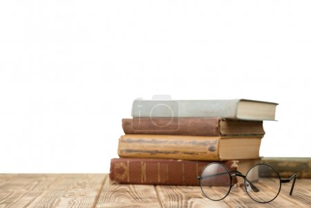 Glasses and books on  table