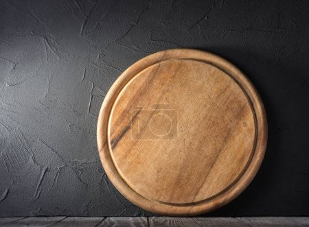 Cutting wooden board on table