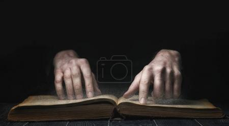 book, hands and dust