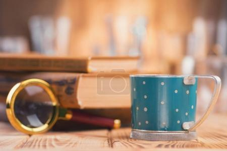Coffee and books on wooden table