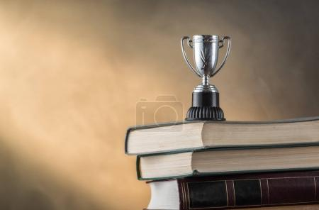 Books and sports cup, close up