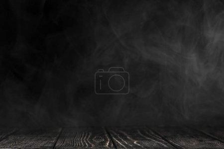 Black tabletop on a black background