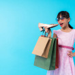 Young asia girl kid holding shoe with shopping bag...
