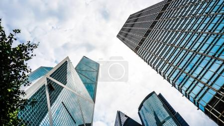 Photo for Modern glass buildings from low angle with sky shot. Concept world finance and eastate business - Royalty Free Image