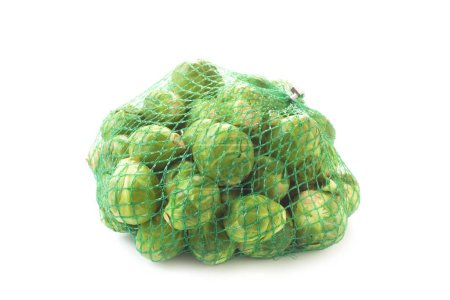 Photo for Close-up shot of Brussel Sprouts In A Net Isolated On White - Royalty Free Image