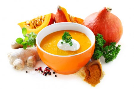 Photo for Pumpkin Soup With Ingredients Isolated On White - Royalty Free Image