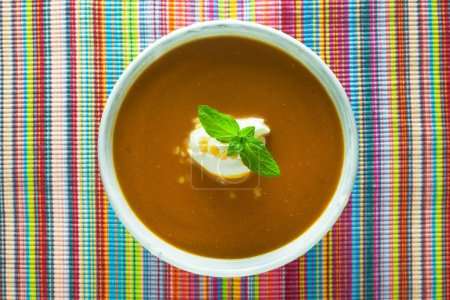 Photo for Hot Red Lentil Soup on A Colourful Background - Royalty Free Image