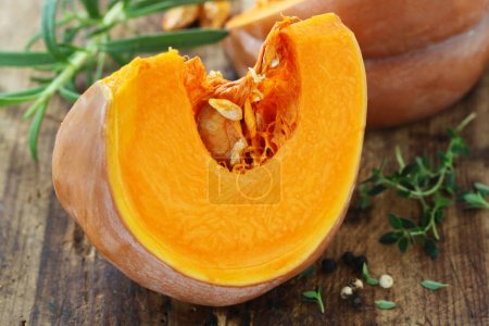 Photo for Close-up shot of Slice Of Muscat Pumpkin On A Wooden Background - Royalty Free Image