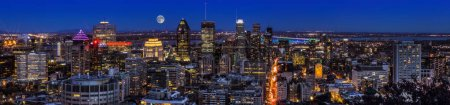 Photo for Amazing view of Montreal city at sunset with colorful neon light building. Montreal panorama at dusk as viewed from the Mount Royal overlook. Magic moon over Canadian city. - Royalty Free Image