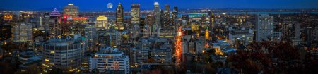 Photo for Montreal panorama at sunset time with blue sky. Amazing town view in the evening. Magic moon over Canadian city. - Royalty Free Image