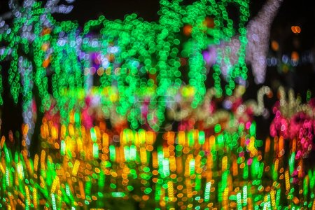 Photo for Abstract twinkled bright background with defocused lights. Majestic tree of lights. Fantastic forest. Unique bokeh effect. - Royalty Free Image
