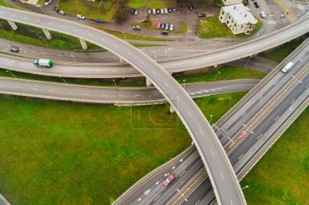 Photo for Aerial view at junctions of city highway. Vehicles drive on road - Royalty Free Image