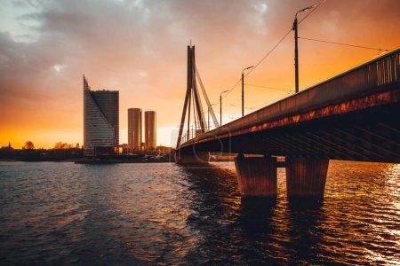 Vansu bridge in Riga cable-stayed bridge  crosses the Daugava river in susnet time