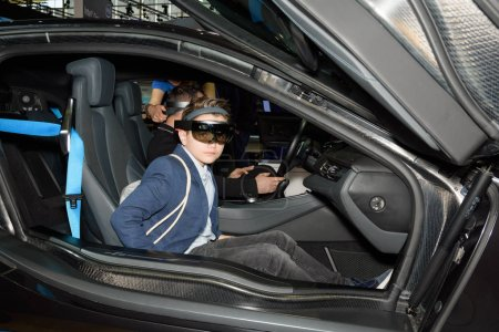 Boy tests the augmented reality at the Intel booth at the CeBIT
