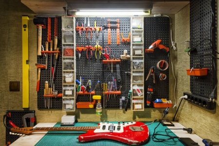 Photo for Luthier's Workbench With A Red Guitar - Royalty Free Image