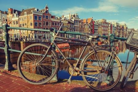 Old bicycles standing next to canal. Traditional Amsterdam citys
