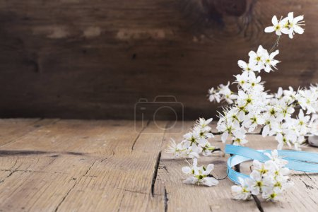 Spring blossom on wooden table.