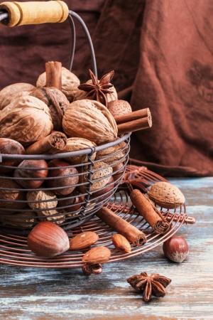 Hazelnuts in bowl n table.