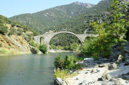 Greece, ancient byzantine arch bridge over river K...