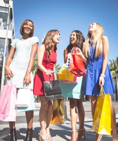 Photo for Multiethnic group of girls shopping. Four beautiful women having fun while buying presents in Beverly Hills - Royalty Free Image