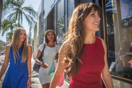Photo for Multiethnic group of girls shopping. Three beautiful women having fun while buying presents in Beverly Hills - Royalty Free Image
