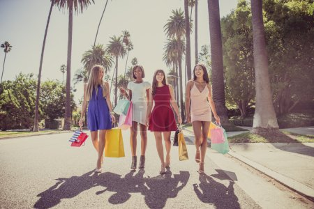 Photo for Multiethnic group of girls shopping. Four beautiful women having fun while buying some presents in Beverly Hills - Royalty Free Image