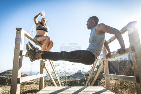 Sportive couple training outdoors