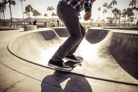 Skater boy practicing at skate park