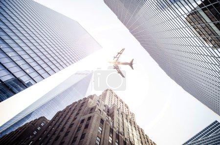 Plane flying over city