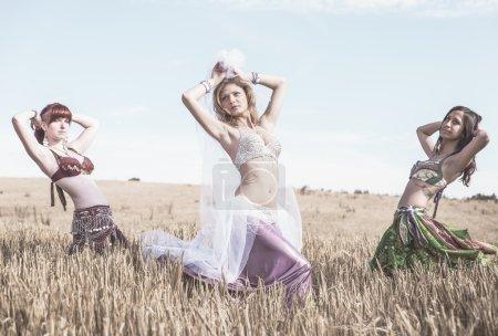 Belly dancers in wheat field