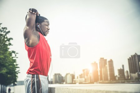 Photo for Sportive handsome man runner training outdoors in New York - Royalty Free Image